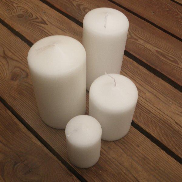 Kerzen in weiß in unterschiedlichen Größen Bild 1