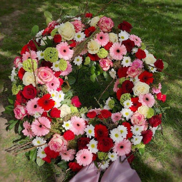 Trauerkranz, rund gesteckt, Rot/Rosa/Weiß Bild 1