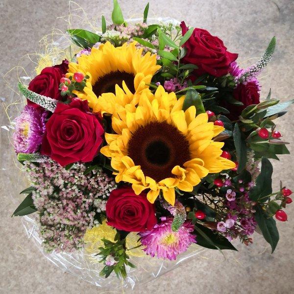 Herbstzauber mit Sonnenblumen Bild 1