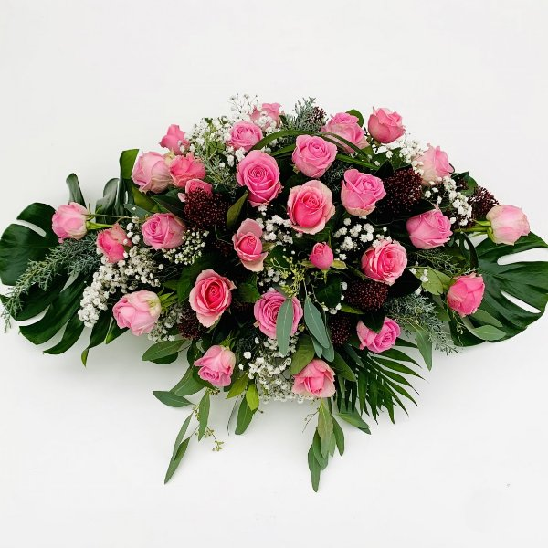 Blumengesteck in rosa Tönen, flach gesteckt Bild 1