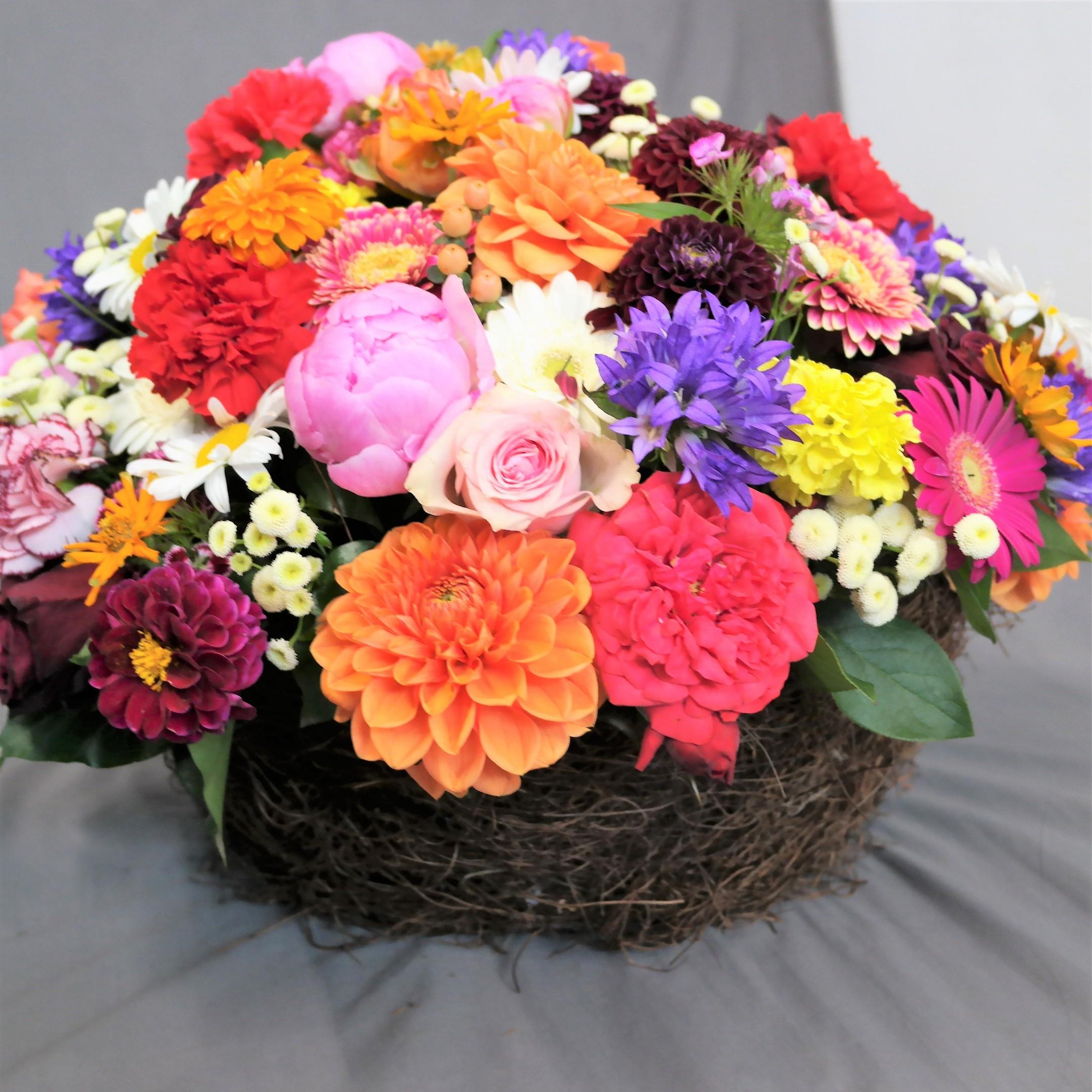 aufgesteckte bunte Blütenschale Bild 1