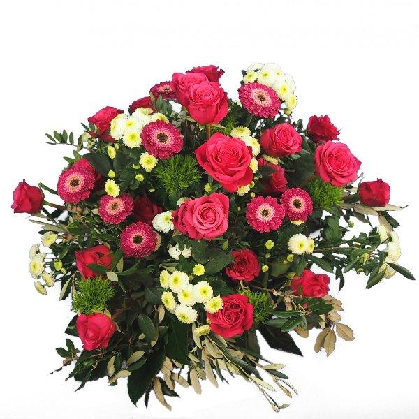 Trauergesteck in magentafarbener Blumenkombination Bild 1