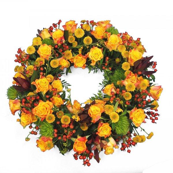 Trauerkranz rundgesteckt, gelb-rote Blumenkombination Bild 2